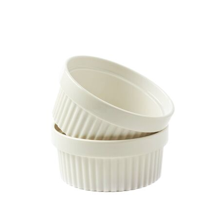 ramekin: Two white porcelain souffle ramekin dishes, composition isolated over the white background Stock Photo