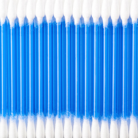 swab: Surface covered with blue cotton swab buds, close-up crop fragment as a background composition