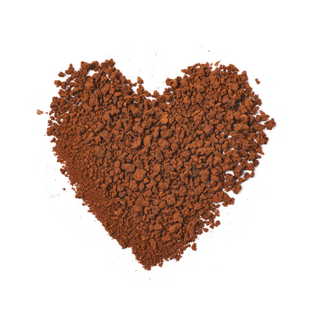 caffiene: Heart shape made of instant coffee grains isolated over the white background