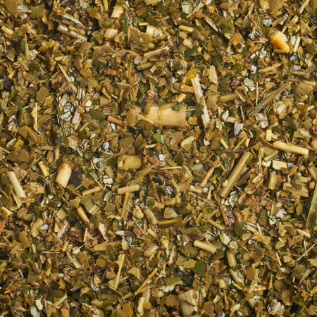 mate: Surface covered with the wet mate tea leaves as a background texture composition Stock Photo