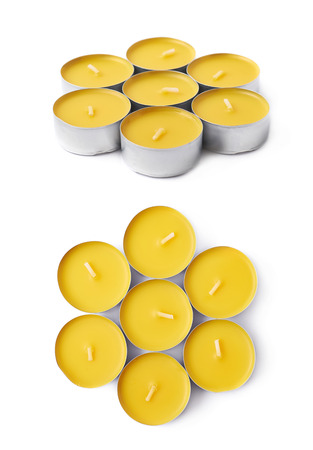 tealight: Pile of tealight paraffin wax yellow candles isolated over the white background, set of two different foreshortenings