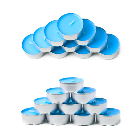 paraffin: Pyramid of tealight paraffin wax blue candles isolated over the white background, set of two different foreshortenings
