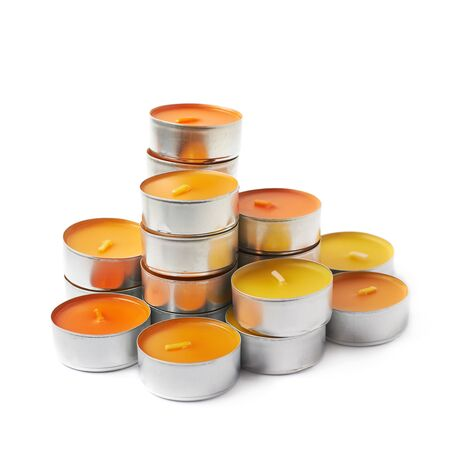 tealight: tealight paraffin wax orange candle isolated over the white background Stock Photo