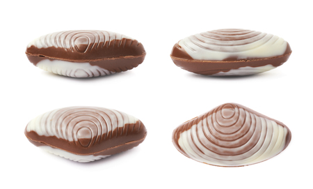 fill up: Shell shaped white and milk chocolate candy isolated over the white background, set of four different foreshortenings Stock Photo