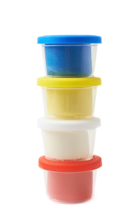 child's play clay: Pile of modeling clay container boxes isolated over the white background