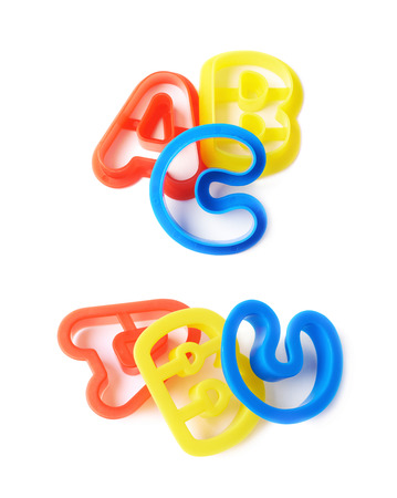 group b: Plastic ABC letter forms isolated over the white background