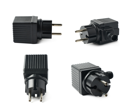 electrify: Black plastic electric adapter isolated over the white background, set collection of four different foreshortenings
