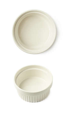 ramekin: White porcelain souffle ramekin dish isolated over the white background, set of two different foreshortenings Stock Photo