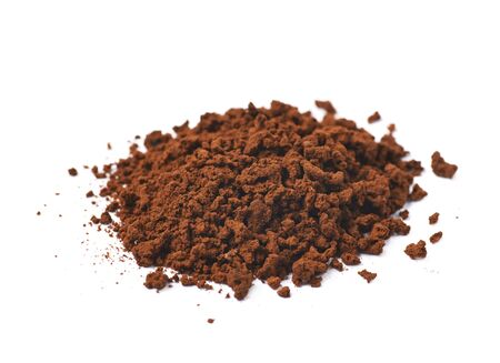caffiene: Pile of instant coffee grains isolated over the white background
