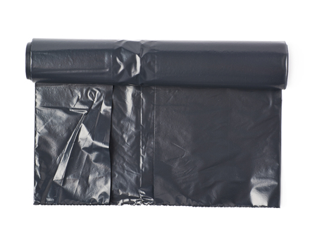 degradable: Roll of black plastic garbage bags isolated over the white background
