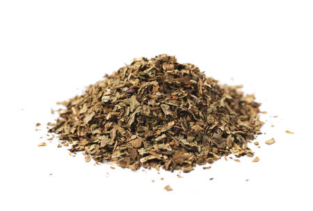 basil: Pile of dried basil seasoning isolated over the white background