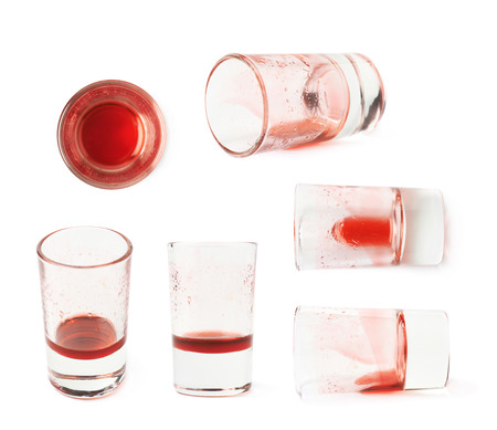 grenadine: Glass shot with grenadine red syrup leftovers isolated over the white background, set of six different foreshortenings