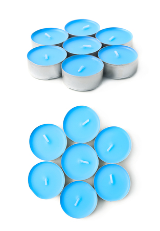 tealight: Pile of tealight paraffin wax blue candles isolated over the white background, set of two different foreshortenings Stock Photo