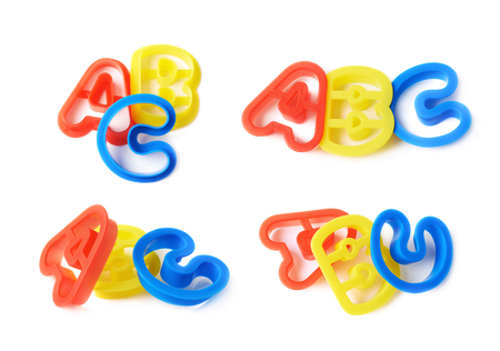 studio b: Plastic ABC letter forms isolated over the white background, set of four different foreshortenings Stock Photo