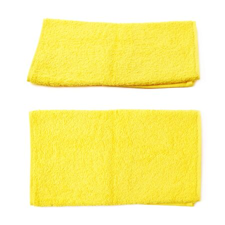 towel: Single yellow terry cloth towel isolated over the white background, set collection of two different foreshortenings Stock Photo