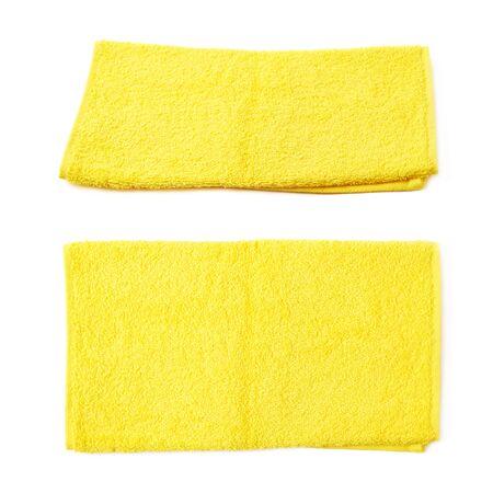 toalla: Sola toalla de tela de color amarillo aislados en el fondo blanco, sistema de recogida de dos escorzos diferentes Foto de archivo