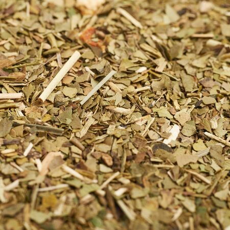 mate: Surface covered with dry mate tea leaves as a background composition Stock Photo