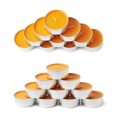 paraffin: Pyramid of tealight paraffin wax orange candles isolated over the white background, set of two different foreshortenings