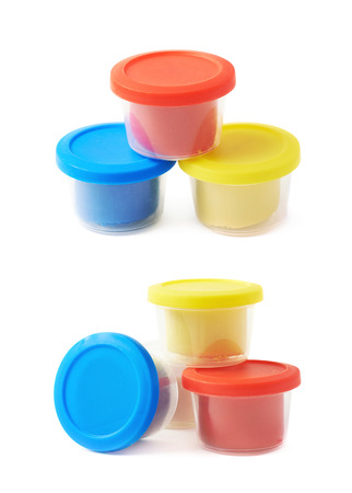 modeling clay: Pile of modeling clay container boxes isolated over the white background, set of two different foreshortenings Stock Photo