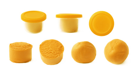 childs play clay: Piece of an orange modelling clay isolated over the white background, set of seven different foreshortenings Stock Photo