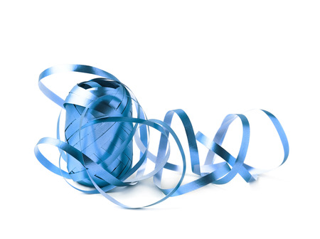unwrapped: Glossy ribbon reel partly unwrapped, composition isolated over the white background