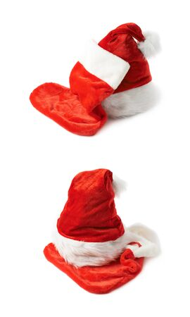stocking cap: Santas red hat cap and Christmas sock shaped bag stocking, composition isolated over the white background, set of two different foreshortenings Stock Photo