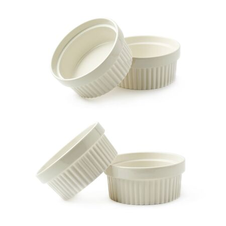 ramekin: Two white porcelain souffle ramekin dishes, composition isolated over the white background, set of two different foreshortenings Stock Photo