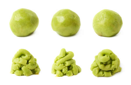 Wasabi paste as a pile or a ball, each in three foreshortenings, isolated over the white background Stock Photo