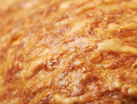 crust: Cheese croissants crust close-up fragment as a backdrop composition