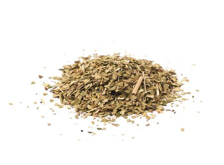 pile of leaves: Pile of dry mate tea leaves isolated over the white background Stock Photo