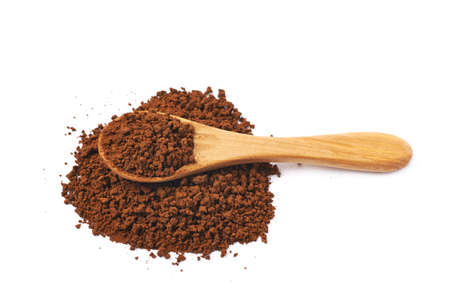 caffiene: Pile of instant coffee grains with the wooden spoon over it, composition isolated over the white background
