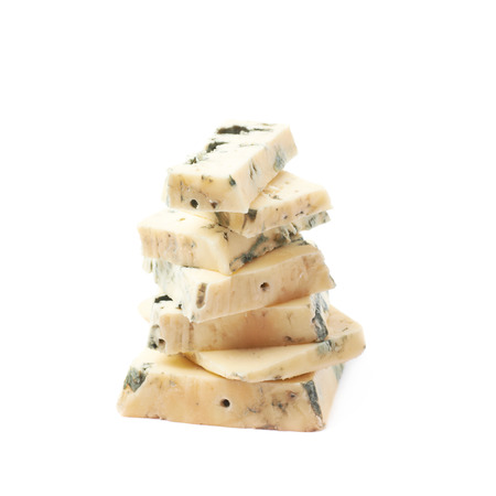 penicillium: Pile of blue cheese slices isolated over the white background Stock Photo