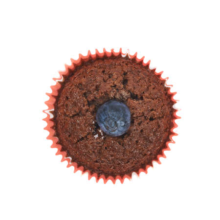 bilberry: Chocolate muffin cupcake with the bilberry, isolated over the white background