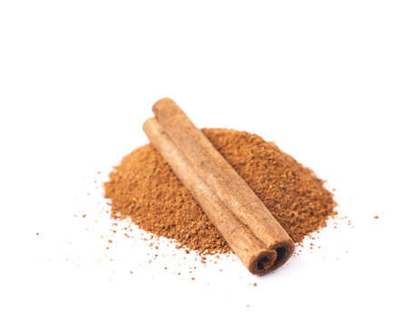 cinnamon bark: Pile of cinnamon powder with the raw bark sticks on top of it, composition isolated over the white background Stock Photo