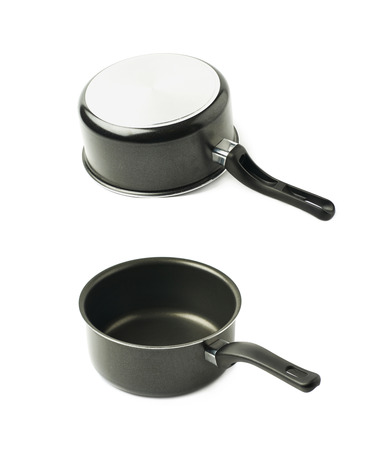 teflon: Teflon coated black sauce pan isolated over the white background, set of two different foreshortenings Stock Photo