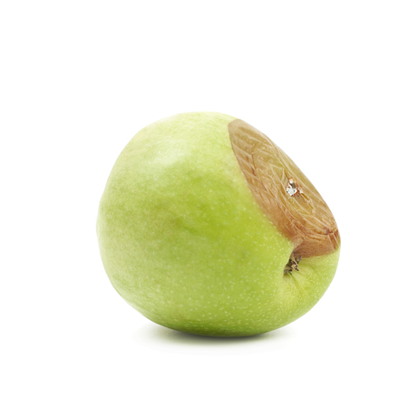 genetic food modification: Rotten green apple fruit isolated over the white background Stock Photo