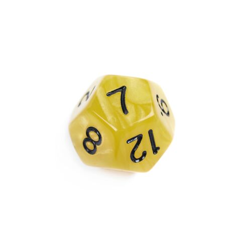 roleplaying: Yellow roleplaying polyhedral dodecahedron gaming plastic dice isolated over the white background Stock Photo