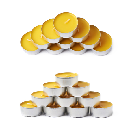 paraffin: Pyramid made of tealight paraffin wax yellow candles isolated over the white background, set of two different foreshortenings