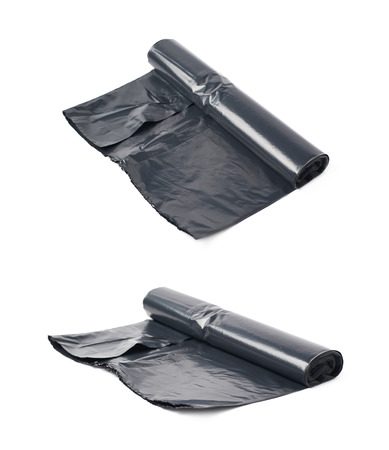 degradable: Roll of black plastic garbage bags isolated over the white background, set of two different foreshortenings