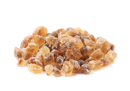 rock pile: Pile of brown rock sugar crystals isolated over the white background Stock Photo