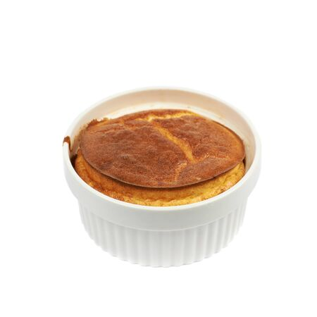 ramekin: Cheese souffle in a white ceramic ramekin, composition isolated over the white background