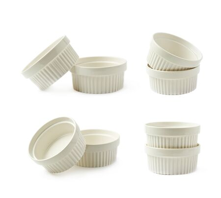 ramekin: Two white porcelain souffle ramekin dishes, composition isolated over the white background, set of four different foreshortenings Stock Photo