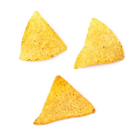 tortilla de maiz: chips de tortilla de maíz amarillo sola aisladas sobre el fondo blanco, conjunto de tres diferentes escorzos Foto de archivo
