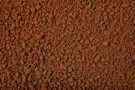 caffiene: Surface coated with the instant coffee grains as a background texture composition