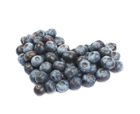 bilberries: Heart shape made of bilberries isolated over the white background Stock Photo