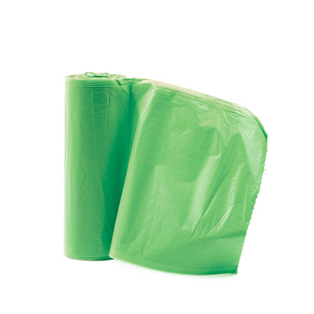 degradable: Green plastic polyethylene trash bag roll isolated over the white background