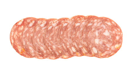 salame: Line of sliced Italian sausage salame napoli isolated over the white background Stock Photo