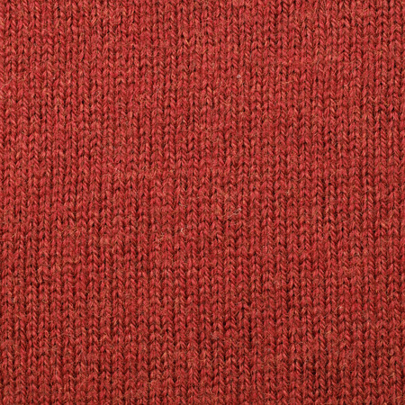 burlap background: Fragment of a red cloth fabric material texture as an abstract background composition