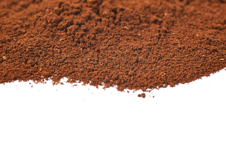 grinded: Pile of the ground coffee flakes isolated over the white background, close-up crop composition Stock Photo