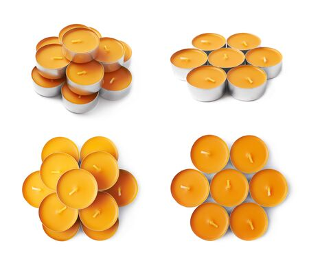 paraffin: Pile of tealight paraffin wax orange candles isolated over the white background, set of four different foreshortenings Stock Photo
